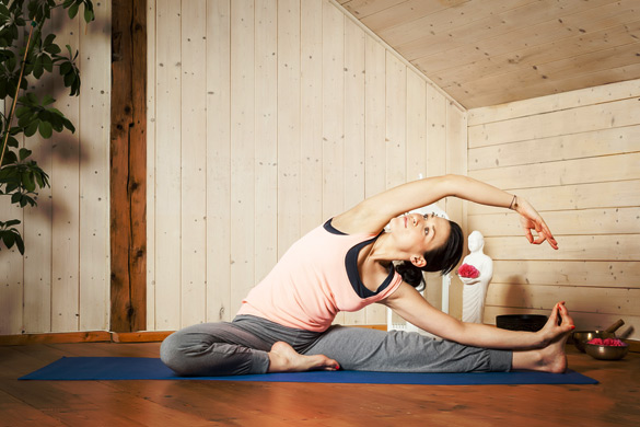pretty-woman-doing-yoga-at-home